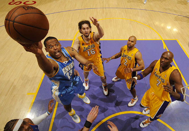 Nuggets center Marcus Camby shoots around a trio of Lakers (from left): Pau Gasol, Derek Fisher and Lamar Odom during Game 2.