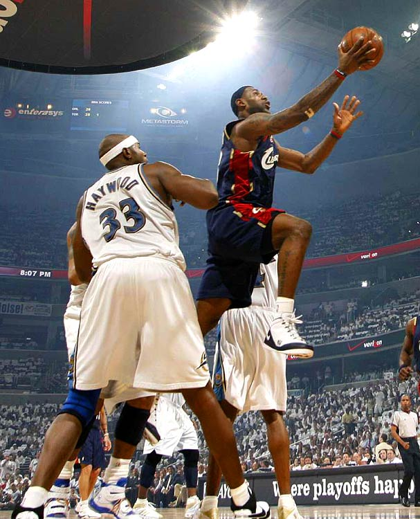 LeBron James shoots around the Wizards' Brendan Haywood during Game 3. James finished with 22 points.