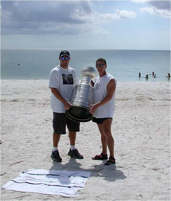The Tampa Bay Lightning's assistant trainer had his day with the Cup in Naples, Fla., on Sept. 2, 2004. I was lucky enough to be at Vanderbilt beach when he brought the Cup out. I have included the picture where I got to hold the Cup (I'm on the right).