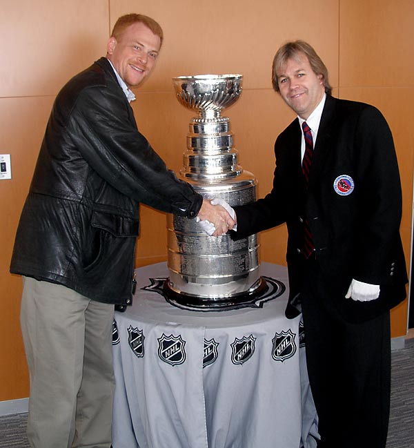 "Guy Wassertzug got his chance to see the Cup at the Washington Capitals' practice facility in March of 2007. Pictured with him is the ""keeper of the Cup,"" -- Phil Pritchard."