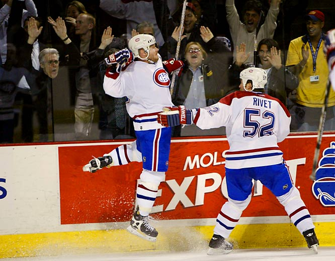The 29th postseason meeting of the storied Original Six rivals saw eighth-seeded Montreal up its dominance to 22-7 with a six-game ouster of the surprise Eastern Conference champs. The Habs were sparked by the return of center Saku Koivu, left, from a season-long battle with cancer, the stellar goaltending of Jose Theodore, and the desire to avenge the concussion and broken nose suffered by Richard Zednik when he was leveled by Boston's Kyle McLaren in Game 4.