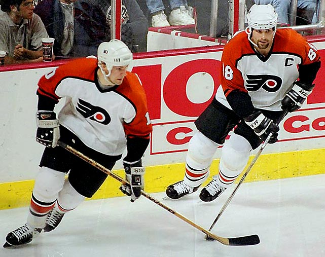 The Next One -- Eric Lindros, right, -- and his Legion of Doom linemates (John LeClair, left, and Mikael Renberg) plus an impressive cast that included Eric Desjardins, Rod Brind'Amour, Mark Recchi, and Kjell Samuelsson chalked up four 100-point seasons but suffered a disappointing loss to eventual Stanley Cup-champion New Jersey in the 1995 Eastern final and an embarrassing sweep at the hands of Detroit in the 1997 Cup final.