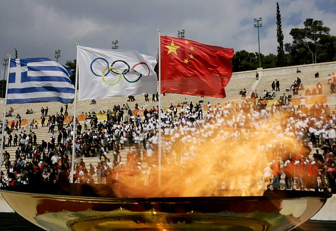 As the cauldron burns, it seemed more security officials than spectators lined Athens' Panathenian Stadium.
