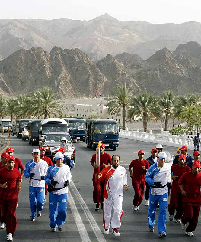 The mountainous backdrop of the only Middle Eastern capital along the torch's route created a postcard-like scene. In what was the most peaceful leg of the relay yet, the flame's stop in Muscat was greeted by thousands, who cheered and danced as it passed through their city.