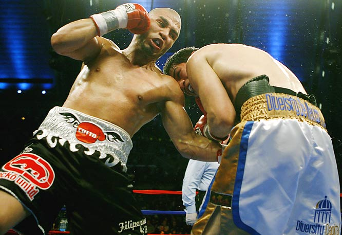 Miguel Cotto ran his record to 32-0 by battering Alfonso Gomez for five rounds Saturday night in Atlantic City to retain his WBA welterweight title.