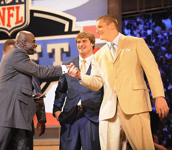 With Jake Long (right) essentially off the board at the start of the NFL draft, the St. Louis Rams opted for Chris Long (center), the defensive end from Virginia and son of former NFL player and current Fox NFL analyst Howie Long with the second overall pick. Trades affected 14 of the 31 first-round picks.