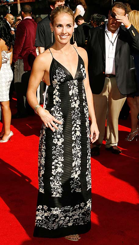 The defender for the U.S. Women's soccer team is on her way to Beijing for the Olympics, but when she's not tackling strikers, Mitts can be seen donning some stunning outfits (and swimsuits for SI!). Did you see that dress she wore at the ESPY's last year?