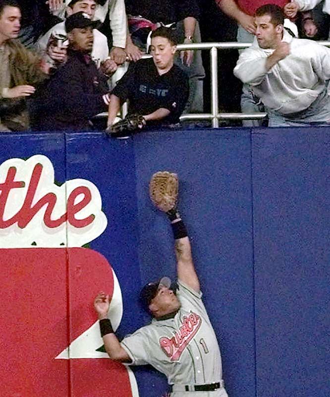 The Yankees' late-'90s dynasty was launched thanks to the help of a 12-year-old Yankees fan sitting in the right-field bleachers. Jeffrey Maier reached over the fence and caught a Derek Jeter flyball before it could settle into Tony Tarasco's glove. Umps incorrectly ruled it a home run. The Yankees would win the game, the AL pennant and the World Series.