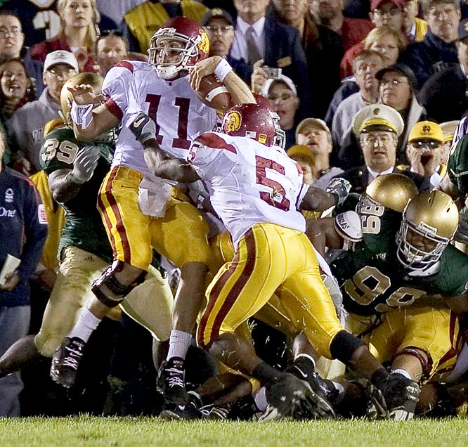 In college football lore, it's known as the Bush Push. Trailing by three against Notre Dame on the game's final offensive play, USC quarterback Matt Leinart was stopped at the goal line but got an illegal push from Reggie Bush to give the Trojans a 34-31 win and extend their winning streak to 28 games.