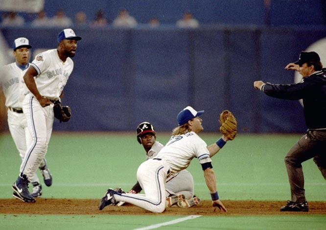 "Here's how SI's Steve Rushin described the blown call in Game 3 of the 1992 World Series: ""In the fourth inning of the first World Series game ever played outside the U.S., Toronto centerfielder Devon White turned, sprinted and made a back-to-the-ball, chest-to-the-wall, backhanded, face-planted catch of a Dave Justice drive to deepest center. His catch touched off what should have been a triple play for Toronto: Braves baserunner Terry Pendleton passed teammate Deion Sanders on the base paths for the second out of the play, and Jay third baseman Kelly Gruber tagged Sanders on the right heel for the third out. Alas, second base ump Bob Davidson blew the call, ruling that Gruber had missed Sanders, erasing what would have been the first World Series triple play since so long ago (1920) that it was the Cleveland Indians who made it."