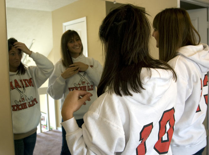 The most popular hang out for the six girls is neither in front of the television nor the kitchen. Rather, it is the upstairs hallway that conveniently features a full-length mirror large enough for a Big Ten field hockey team.