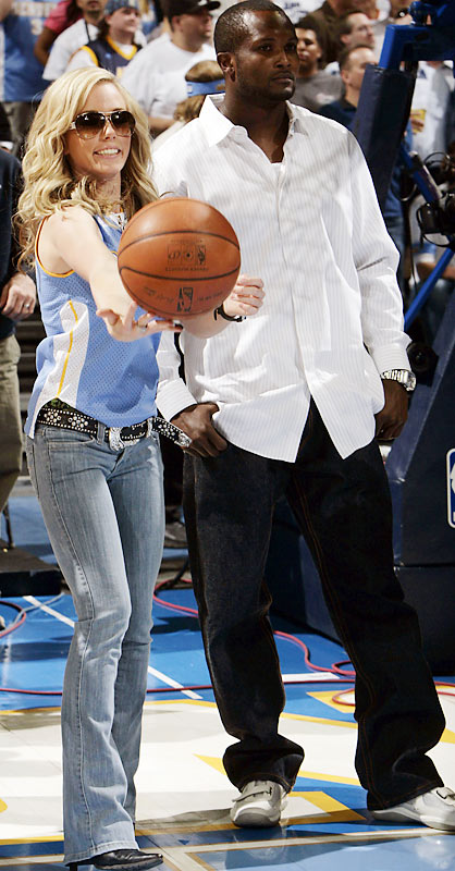 Broncos cornerback Champ Bailey, shown here at Monday's Lakers-Nuggets game, doesn't look too impressed by 'Girls Next Door' star Kendra Wilkinson's ball-handling skills.