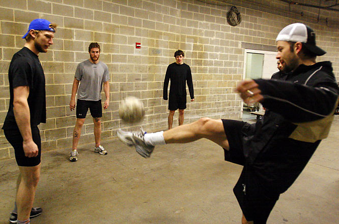 Pittsburgh Penguins (from left to right) Jordan Staal, Ryan Malone, Evgeni Malkin and Petr Sykora warmed up for Tuesday's game against the Flyers by kicking around a soccer ball.