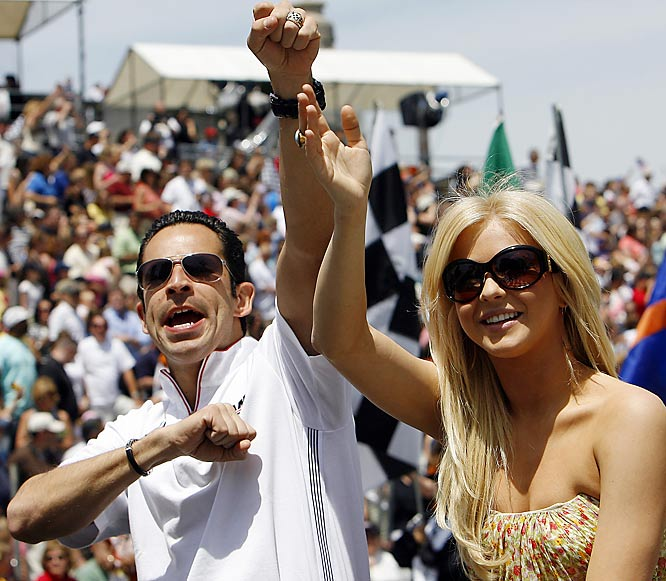 IRL driver Helio Castroneves and his former 'Dancing with the Stars' partner Julianne Hough waved to the crowd during the IRL 500 Festival Parade last Saturday.
