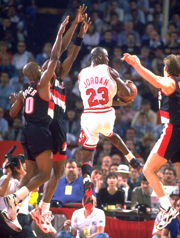 Chicago's Michael Jordan scores a record 35 points, including a record six 3-pointers, in the first half as the Bulls beat Portland 122-89 in the opening game of the NBA Finals.