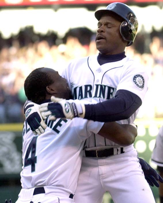 Seattle's Rickey Henderson draws his 2,000th career walk, joining Babe Ruth and Ted Williams as the only players in baseball history to reach the milestone.