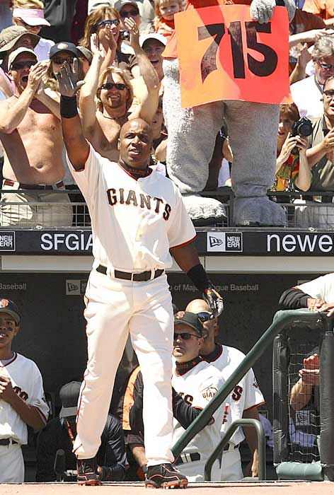 Barry Bonds hits his 715th home run during the San Francisco Giants' 6-3 loss to the Colorado Rockies to pass Babe Ruth and pull closer to Hank Aaron's record of 755.