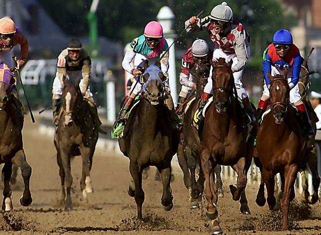 Three-year-old Empire Maker (center) was the top pick (5-2) heading into the 129th Kentucky Derby, but the colt finished second. Instead, the New York-bred gelding Funny Cide (2nd from right) took the crown.