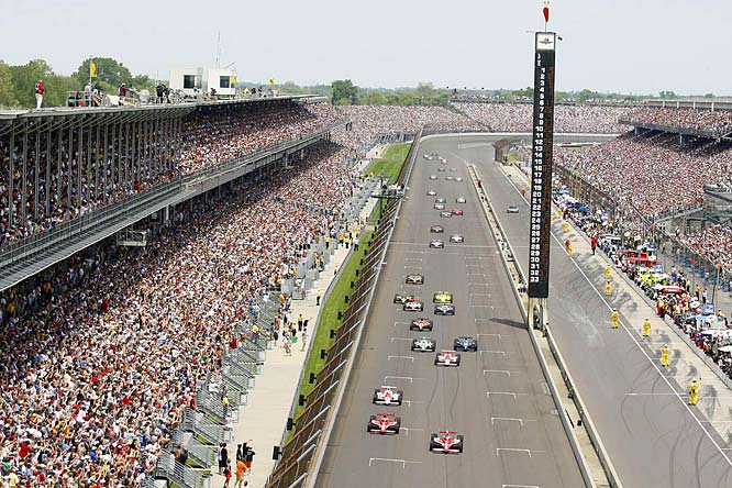 The scene at the start of the 92nd running of the Indianapolis 500. Scott Dixon (9) and teammate Dan Wheldon (10) lead the cars on the first lap. Dixon went on to won his first Indy 500.