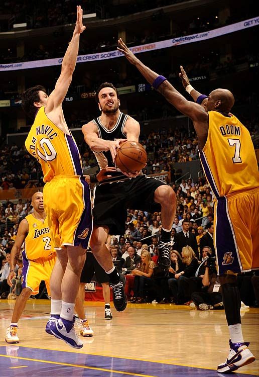 Spurs guard Manu Ginobili (20) splits the Lakers defense. He scored 10 points.