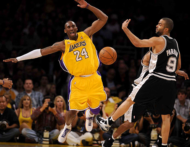 Lakers guard Kobe Bryant (8) defends Tony Parker (9) during Game 2. The Lakers routed the Spurs 101-71.