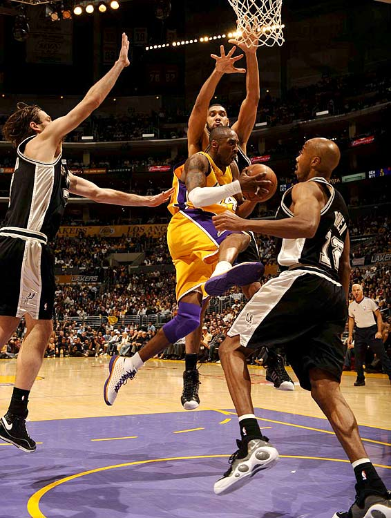 Kobe Bryant drives against Fabricio Oberto (7), Tim Duncan (21) and Bruce Bowen (12) during a 101-71 win in Game 2.