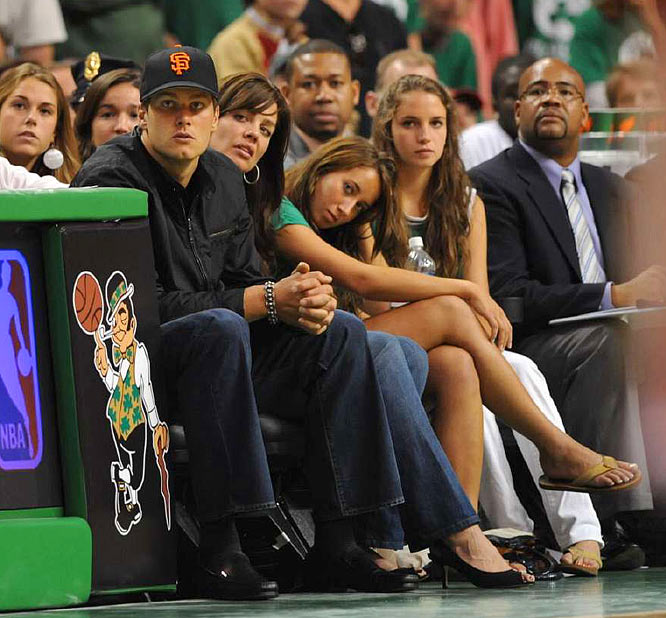 Tom Brady, quarterback of the New England Patriots, at courtside during the game.