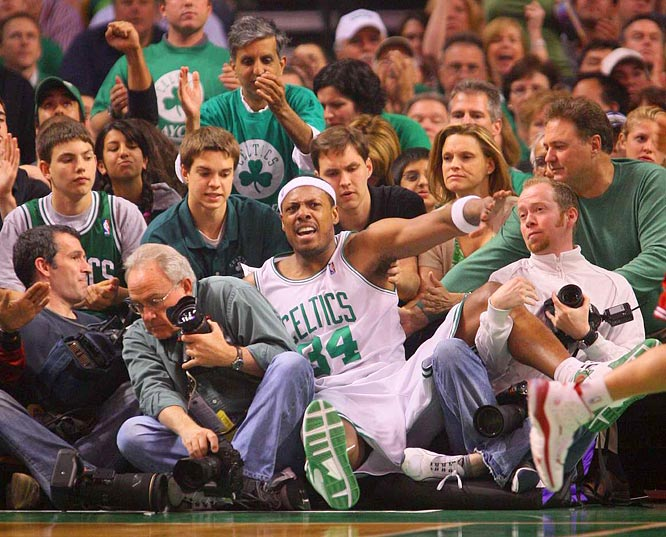 When Pierce took a spill under the basket, he landed in the lap of Sports Illustrated's Staff Photographer John Biever, left.