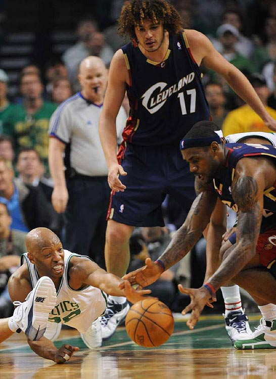 Celtics guard Sam Cassell and LeBron James fight for a loos ball during Game 2 in Boston.  Cassell only scored one point off the bench but provided a veteran leader at the point.