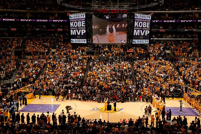 Before the game, Kobe Bryant was awarded the trophy for being named the MVP trophy, the first of his 12-year career.