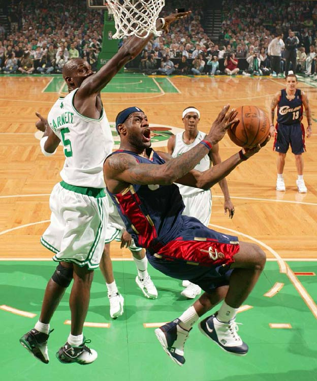 LeBron James drives past Kevin Garnett for two of his 21 points in the Cavs' Game 2 loss in Boston. James was just 6-for-24 from the field as the Cavs fell into an 0-2 hole in the series.