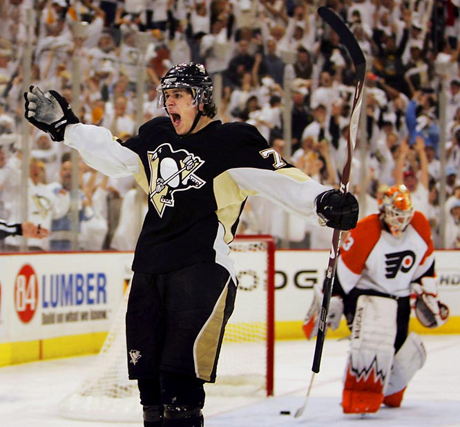 Entering the series without their best defenseman -- Kimmo Timonen (blot clot) -- put the Flyers behind the proverbial eight ball as the battle of bitter Pennsylvania rivals began. Evgeni Malkin (left) scored twice for the Penguins while playing a robust physical game that included numerous checks, hits and even a facewash to Flyers backliner Derian Hatcher. Marian Hossa made his presence felt defensively as the Penguins began to establish themselves as more than a run-and-gun squad.