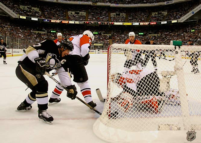 "The Flyers put a bulls-eye on Evgeni Malkin and delivered a crushin' to the Russian forward, but couldn't contain his superstar sidekick, Sid ""The Kid"" Crosby, who opened the scoring when his attempted pass was deflected by a Flyers defender past goalie Martin Biron. Crosby (left) had another apparent goal waived off after a video review. Most devastating for Philly was the loss of blueliner Braydon Coburn, who was hit in the eye by a puck shot by Sergei Gonchar (three assists) only 1:51 into the first period."