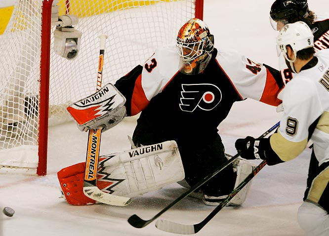 Desperate and on the brink of elimination, the Flyers came out banging and Martin Biron (left) summoned the form that made him an early Smythe Trophy candidate. The netminder stopped 36 shots, many in spectacular fashion. Scott Hartnell was the offensive star, dishing three assists when not delivering crunching checks. On the Pens' side of the ledger, 19-year-old center Jordan Staal returned from the death of his grandfather to score both of Pittsburgh's goals.