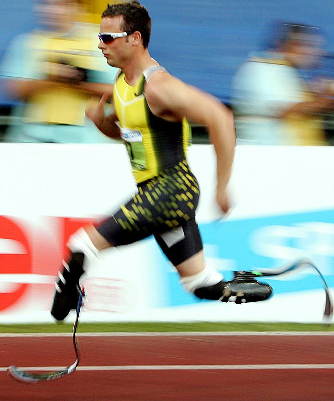 "Double-amputee sprinter Oscar Pistorius won a major victory when the Court of Arbitration for Sport ruled that the Olympic hopeful's so-called ""blades"" did not give him an unfair advantage, clearing him for a spot on the South African Olympic squad.  He still needs to shave about a half a second off of his time to qualify for the 400 meters, but could be picked for a spot on a relay team."