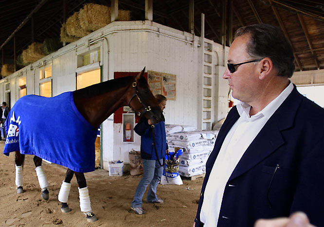 Big Brown was forced to take two days off for a small crack on the inside of his left heel, something his trainer, Richard Dutrow Jr. (right), promises won't affect his Belmont Stakes status.
