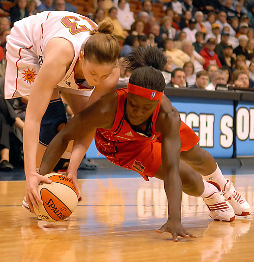 College Team:  Rutgers Scarlet Knights<br>College Stats:  12.2 ppg, 5.2 apg, 3.6 rpg<br>WNBA:  Fifth overall pick