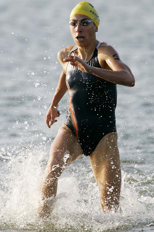 At the triathlon world championships in August, she finished 12th out of 13 competitors in the swim, moved up one spot after the bike phase, then calmly dusted the field in the 10-kilometer run to win the title with a minute to spare. Since 2004 Fernandes has won 18-of-20 World Cup events, and her 19 total victories on the circuit tied her with Australia's Emma Carney for the career record.