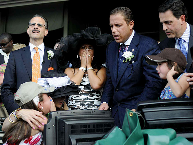 Big Brown's co-owners Richard Schiavo, left, and Michael Iavarone react as their horse brings up the rear.