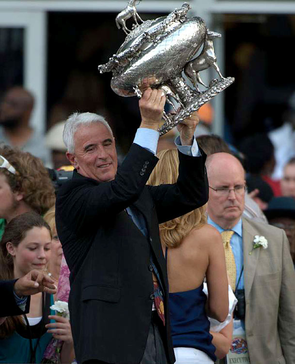 Veteran Trainer Nick Zito hoists the trophy in the Winner's Circle after Da'Tara's victory in the 2008 Belmont Stakes.
