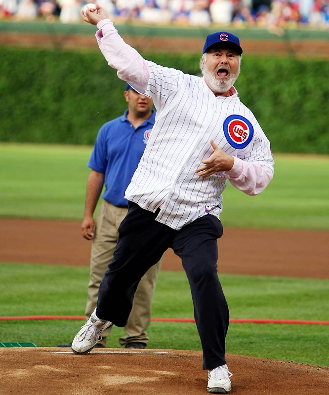 Director Rob Reiner puts a lot of effort into his first pitch before Wednesday's White Sox-Cubs game.