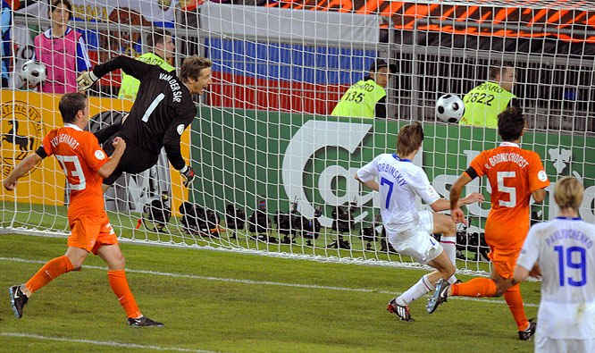 Locked in a 1-1 tie with the Netherlands, the Russians required a moment of brilliance to settle their quarterfinal staredown. After bravely carrying the ball from midfield down to the goal line, Andrei Arshavin looped a dazzling rainbow across the mouth of the goal for the surging super sub Torbinski, who punched the cross into the net for Russia's game-breaking goal in the 112th minute.