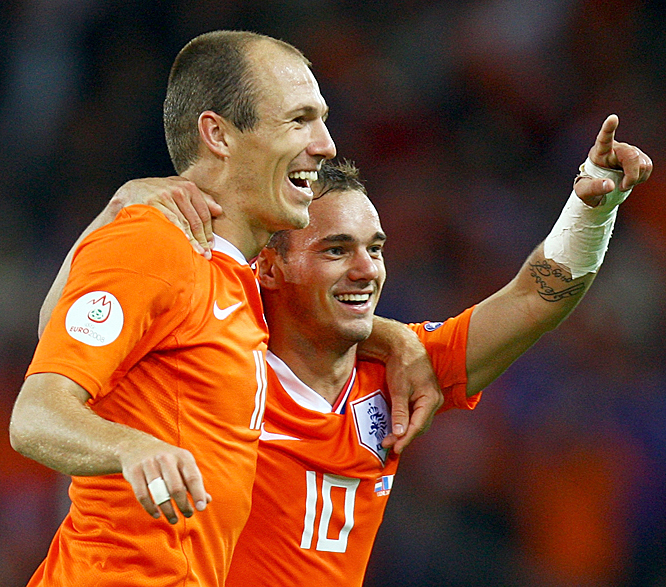 Sneijder (right) put an exclamation point on Holland's dismantling of the French, rifling a shot past goalkeeper Gregory Coupet off the underside of the crossbar into the net. The goal punctuated a convincing 4-1 victory, which clinched a first-place finish for the Dutch in Group C and a place in the quarters.