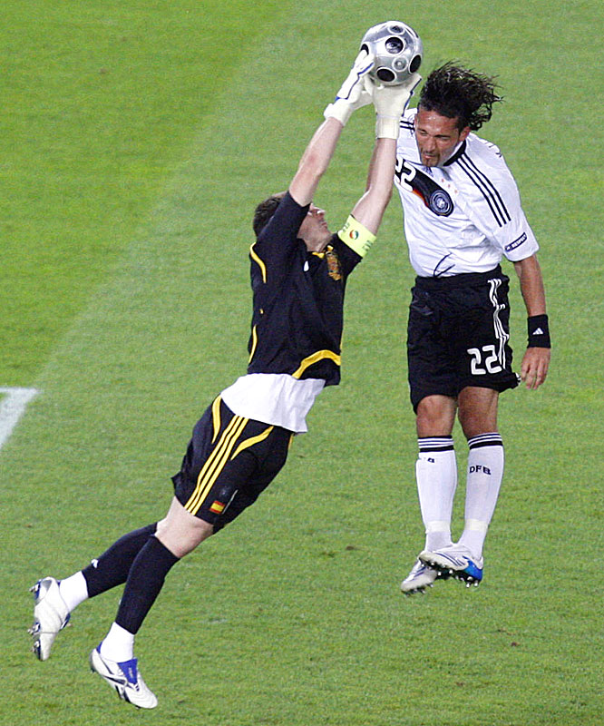 Spanish goalkeeper Iker Casillas, who allowed just three goals in the tournament, punches away a ball headed toward Germany's Kevin Kuranyi.