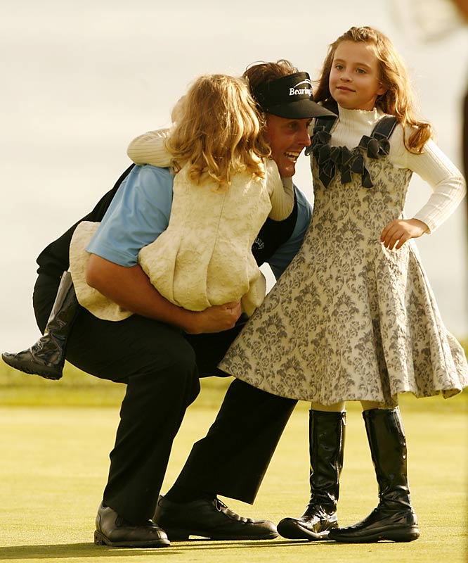 Two-time Masters winner Phil Mickelson poses with his daughters, Sophia (left) and Amanda, who have both caddied for him at the tournament's Par-3 contest.