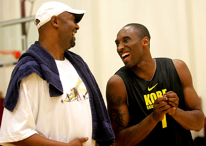 Kobe Bryant and father, Joe, share a moment as they play in a pickup basketball game.