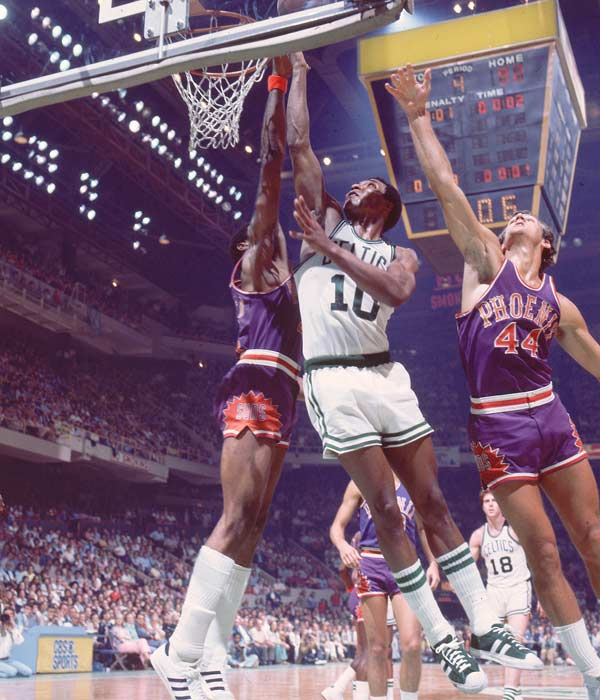 Boston's Jo Jo White scored 33 points as the Celtics outlasted Phoenix 128-126 in triple-overtime in Game 5 of the NBA Finals. Phoenix forward Gar Heard, who set a then Finals record by playing 61 minutes, hit a buzzer-beater to force the third overtime.