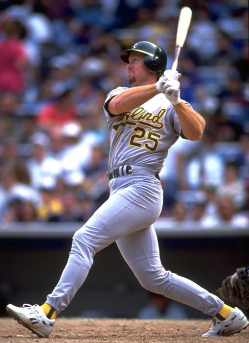 At Milwaukee County Stadium, Oakland first baseman Mark McGwire hits his 200th career home run off Milwaukee pitcher Chris Bosio.