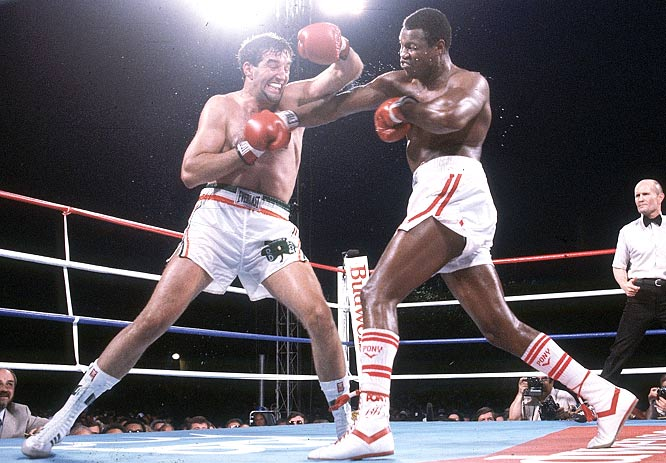 Larry Holmes beats Gerry Cooney in the 13th round by TKO to maintain the WBC heavyweight title.