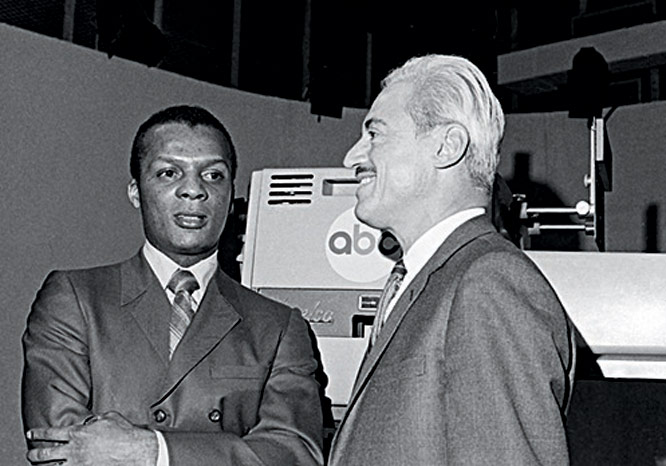 The U.S. Supreme Court, by a vote of 5-3, confirms the lower court's ruling in the Curt Flood case, upholding baseball's exemption from antitrust laws. Flood (pictured here with former players' union head Marvin Miller) challenged baseball's reserve clause and sought free agency.